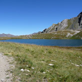 Dive into the Egorgeou Lake as you tour around Queyras to reach your base camp from Guillestre.