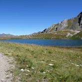 Neem een duik in het meer Le lac d'Egorgeou tijdens uw rondrit door Queyras met Guillestre als thuisbasis!